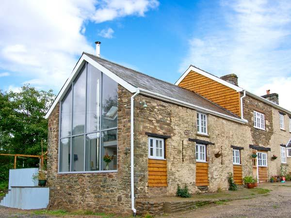 THE BARN AT GLANOER, stone-built barn conversion, roll-top bath, woodburner, an away-from-it-all location, near Hundred House, Ref 22968 - Image 1 - Hundred House - rentals