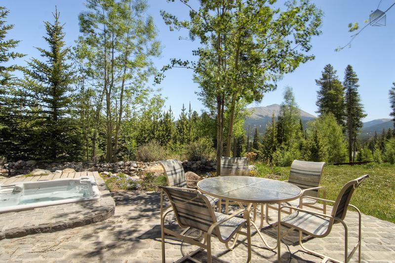 Enjoy great views from the back patio and sunken hot tub! - Massive Ski-in/Ski-out castle with private theater, hot tub, and beautiful mountain views - Ski Home Chalet - Breckenridge - rentals