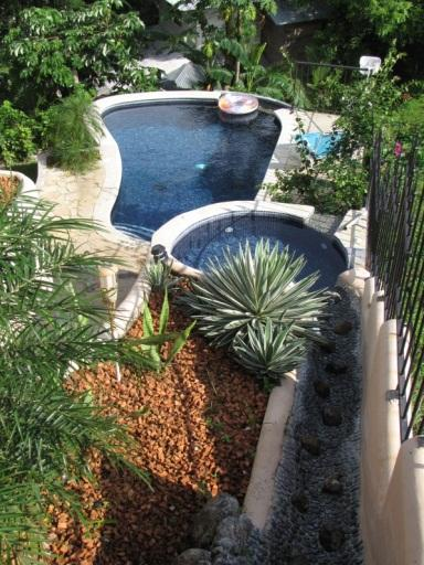 Refreshing waterfall and pool - Tropical Ocean and Mountainview at Villa Celeste - Playa Potrero - rentals