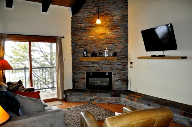 New stone fireplace, furniture and TV - Rockies 2 Bed-Renovated, Walk to Ski, Top Flr/Deck - Steamboat Springs - rentals