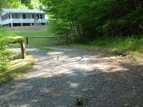 Through the tree-lined drive...across the creek... - Peaceful Cottage with Private Hiking Trails - Marshall - rentals