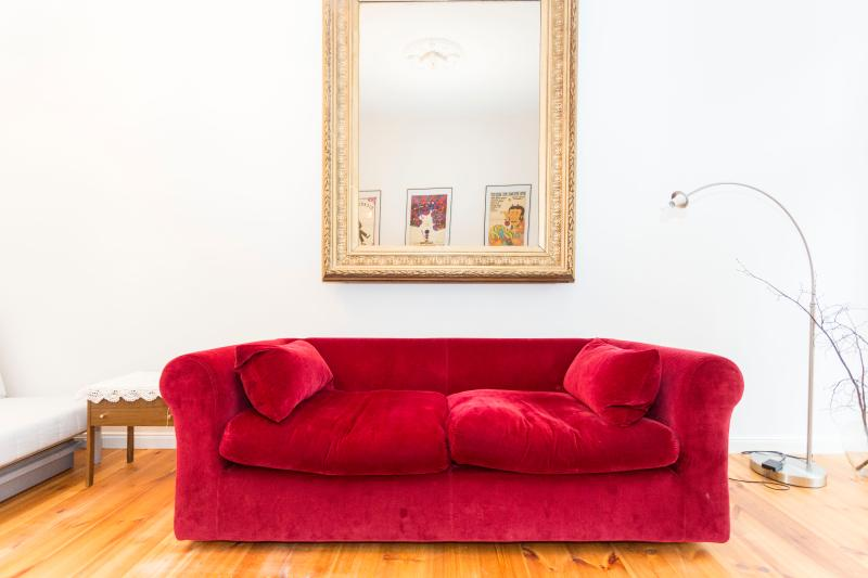 Old Vintage mirow from a Berlin restaurant paired with a modern couch - Fabulous Apartment at Belle Etage in Kollwitzkiez, Berlin - Berlin - rentals