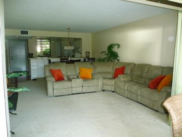From lanai into living room...New sectional sofa in living room - Lake View 1st Floor Condo near IMG & Ocean - Bradenton - rentals