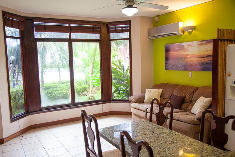 Bright colorful living room and ocean breezes - Beachfront Getaway on Best Part of Jaco Beach - Jaco - rentals