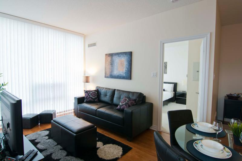 Living Room - 2 Bedroom Furnished Suite, Square One, Mississauga - Mississauga - rentals