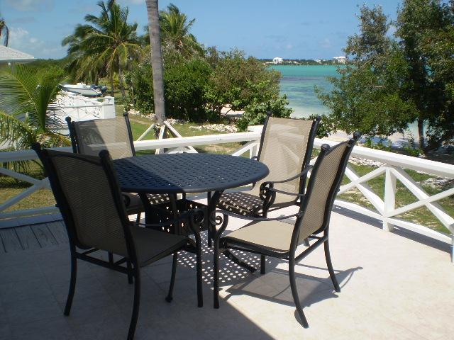 Back patio deck facing your own private beach - BEACHFRONT Exuma Vacation Rentals - Great Exuma - rentals