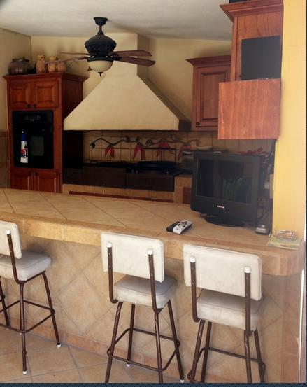 Outdoor patio and grill will the bar seating area - The Sting Ray - Puerto Penasco - rentals