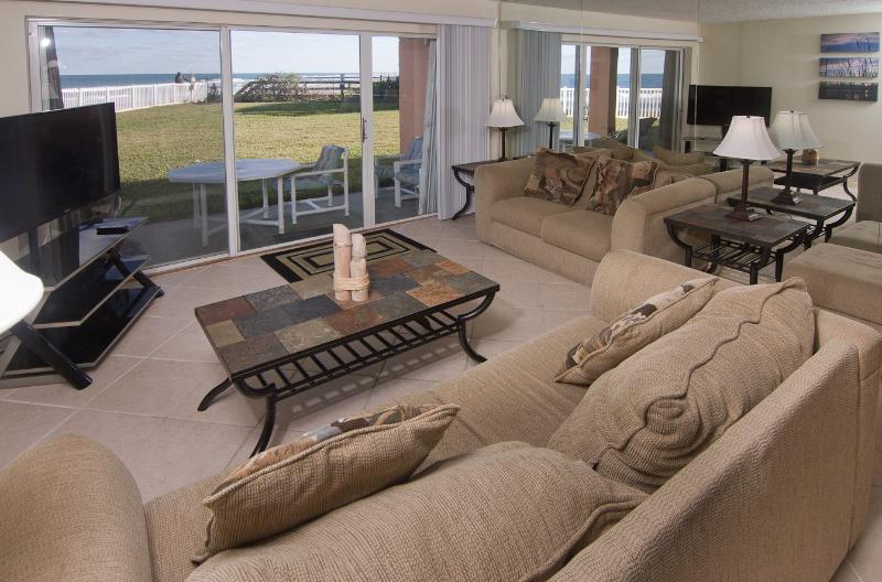 Living room with oceanfront view and new 50