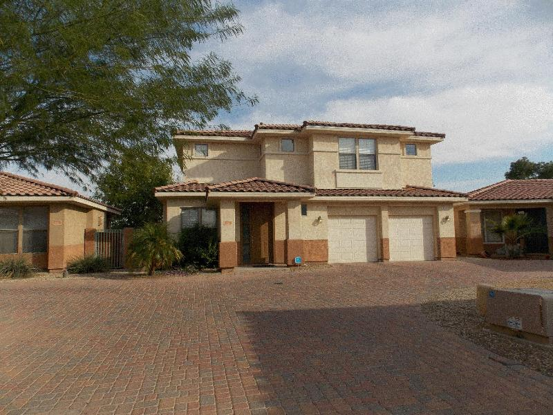 Front of home with double garage - Summer Fun in the Sun; Fall Break or Golf Week - Goodyear - rentals