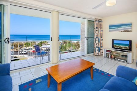 View from the living area.  The unit has a small balcony with chairs and table. - Magnificent Ocean Views at Kings Beach, Queensland - Kings Beach - rentals