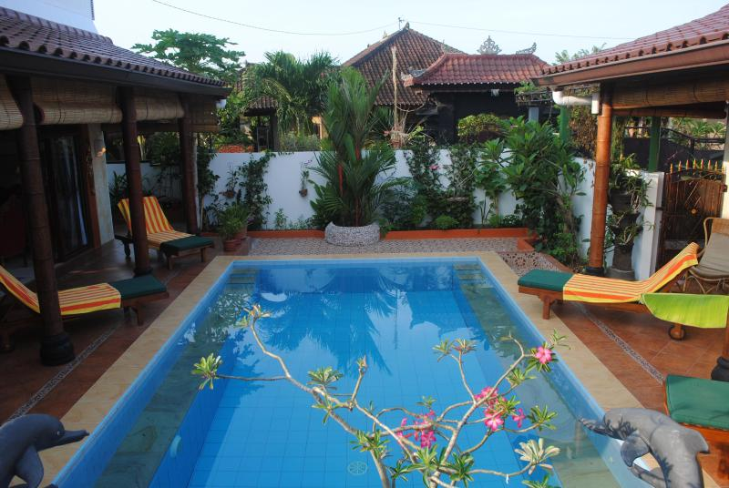 Pool separating the Main house and the Guesthouse - Tropical Oasis - amazing full views: Pool Suite - Jimbaran - rentals