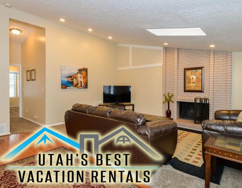 Family room with fireplace, flatscreen TV, comfortable sofas, and vaulted ceiling - Cottonwood Ski Duplex + 2 Separate Units Available - Salt Lake City - rentals