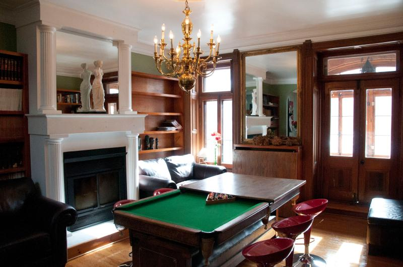 Spacious living room with lots of seating and a Billiard table. - Plateau Heritage House - Montreal - rentals