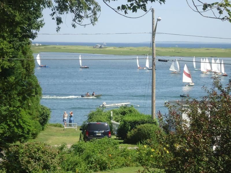 view from deck across salt pond with ocean in the background and sailboats racing on a perfect day. - Charming Home with amazing ocean views, in Private - Westerly - rentals