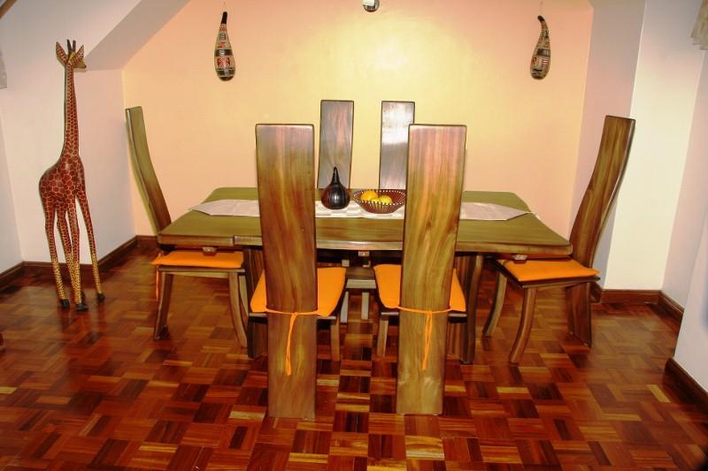 African Themed Dining Area Featuring Six Piece Mahogany Dining Set - GeoMara Penthouse Lavington + Car Nairobi - Nairobi - rentals