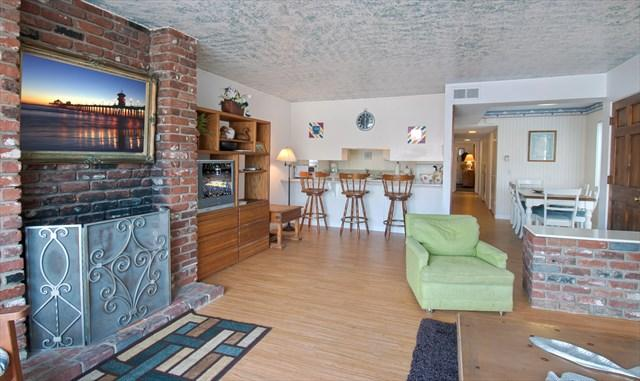 Interior picture showing fireplace, family room and bar countertop to kitchen - 1819 A W. Balboa- 3 Bedroom 2 Bath - Newport Beach - rentals