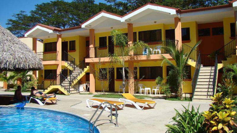 Unit 72 is the right upstairs on the left - 2 Bdrm 1 Bath Condo, 2 Bikes, 2 Snorkeling gear, 2 Fish poles, Air mattresses, sun bathing lounges, Pool, all included - Playas del Coco - rentals