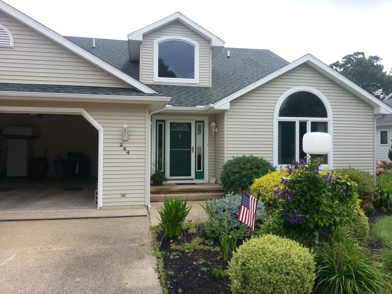 Front of house, showing master bedroom window to the right of door - Beautiful, sunny home on Salt Pond golf course - Bethany Beach - rentals