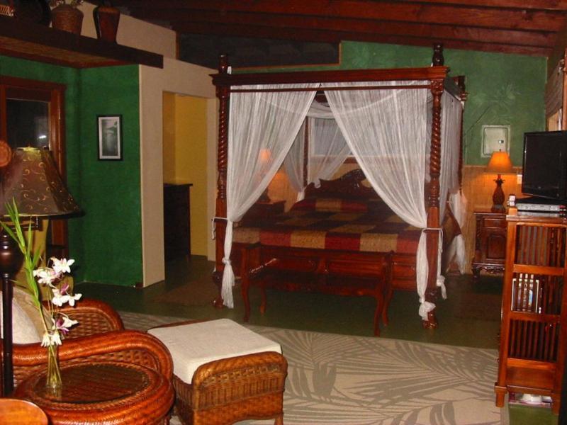 Indonesian teak furniture provides a romantic tropical comfort - Romantic S Kona Cottage wth  Incredible Oceanview - Captain Cook - rentals