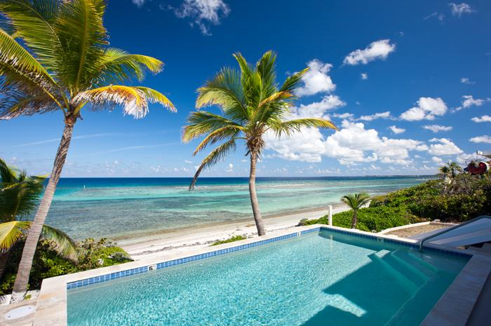 View of the Pool and the Ocean - Coral Loft - Casual Living With A Luxurious Twist - North Side - rentals