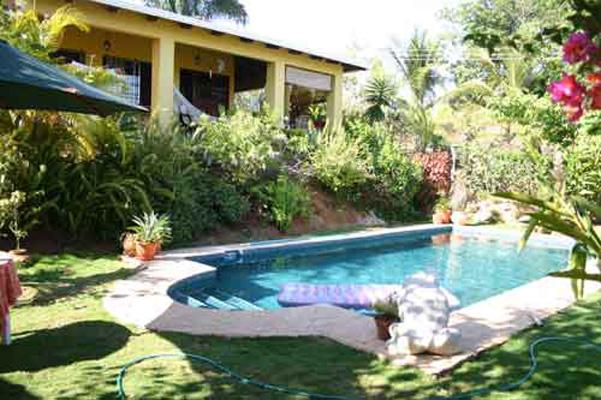 House from pool area - Esterillos Oasis - Costa Rica beach home - Playa Hermosa - rentals