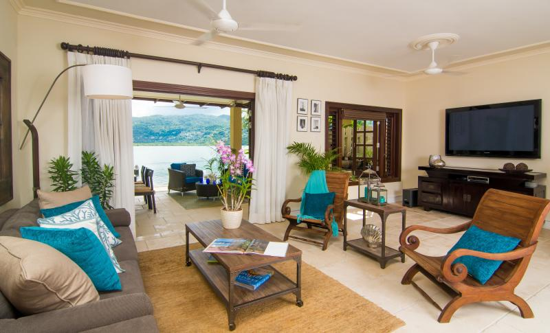 The beautiful living room with view to back patio - Lazy Laguna  - New Waterfront 4 bed/4bath Villa - Montego Bay - rentals