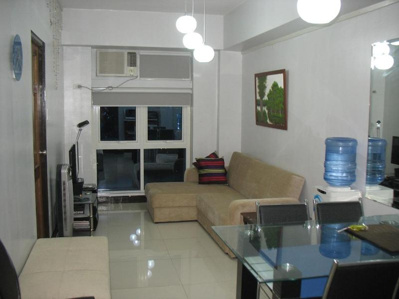 View on entry to awesome condo in Le Grand Tower 1: Air-conditioned open living and dining area - New Condo w/ WiFi Kitchen Gym in Eastwood City - Quezon City - rentals