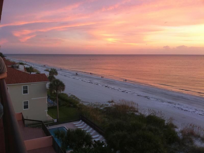 Sunset and heated pool view from balcony of 603. - New Listing! Updated Florida Beach Front Condo! - Indian Shores - rentals