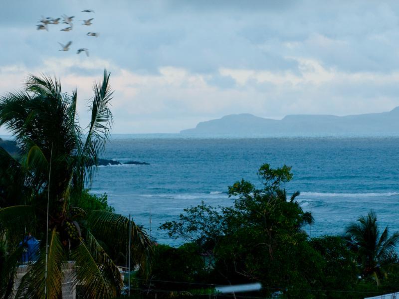 Balcony View, Santa Fe Island in the background - Ocean View Balcony Two Bedroom Apartment - Puerto Ayora - rentals
