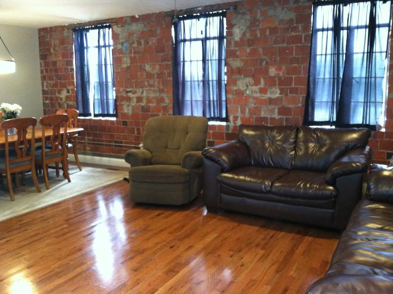 "Living area and kitchen table, original brick wall from 1913 with original windows. - Shenandoah Valley, ""The Building"" circa 1913 - Virginia - rentals"