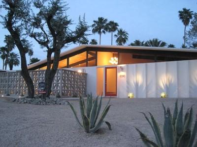 Twilight frames the palm trees and this meticulously restored mid-centry gem - Gorgeous Mid-century Gem with Amazing Views!! - Palm Springs - rentals
