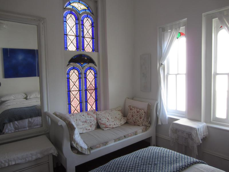 Stained glass windows and Sleigh Bed - Des Artistes Master Bedroom at Church Des Artistes - Kingston - rentals