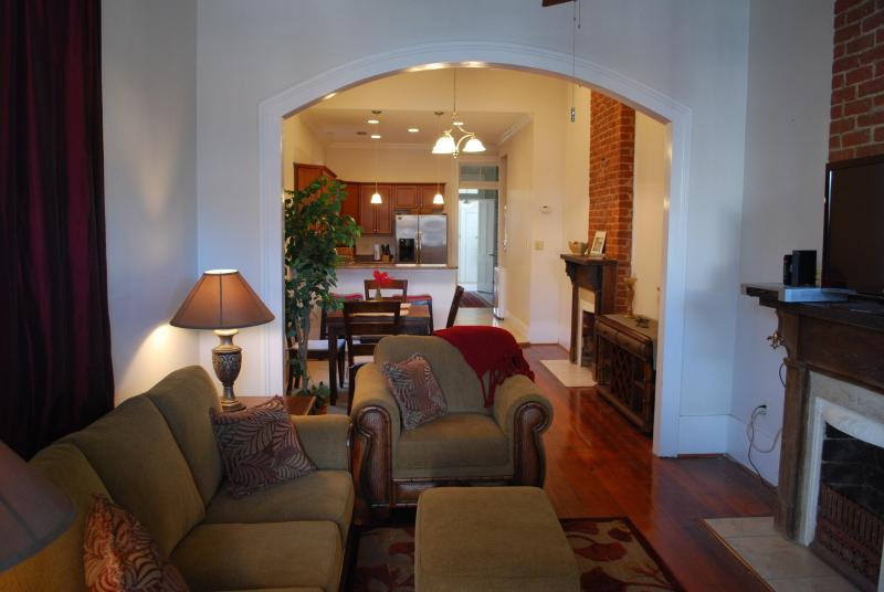 Comfortable living room with cable TV, Wi-Fi, 12-foot ceilings, and hardwood floors. Sofa sleeper. - Historic Algiers Point -- Ferry To French Quarter - New Orleans - rentals