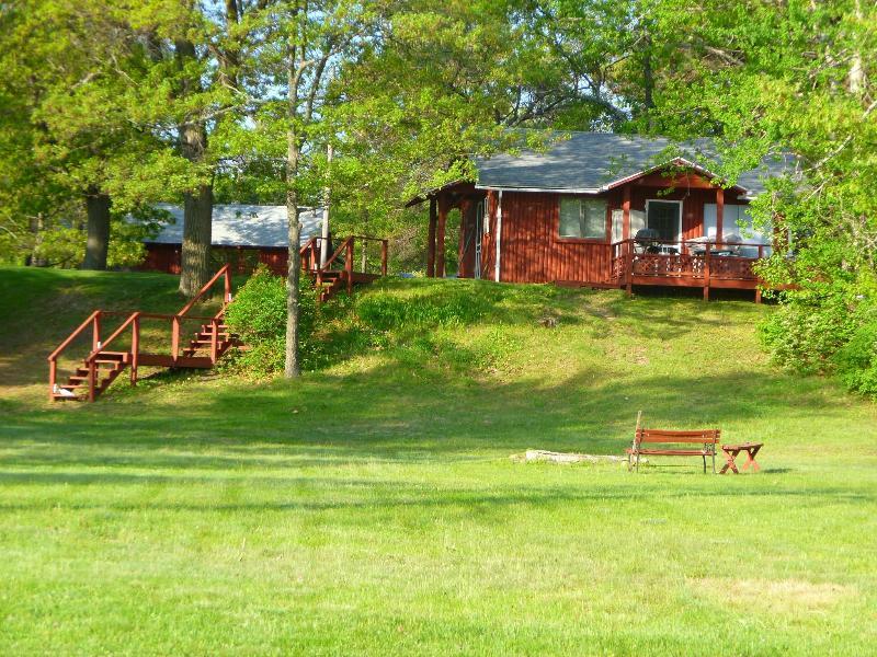 cabin as seen from lake side, owners cabin in background - 2 bedroom log cabin on Van Etten lake in Oscoda - Oscoda - rentals