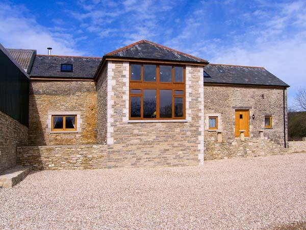 THE OLD BARN, wet room, stunning barn conversion, woodburner, pet-friendly, WiFi, detached cottage near Swanage, Ref. 906024 - Image 1 - Langton Matravers - rentals