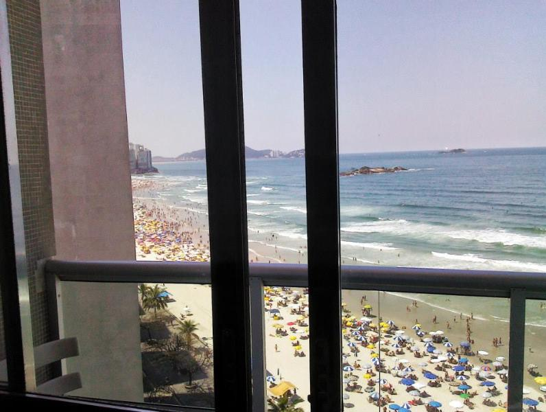 Beach view from the living room (Pitangueiras Beach) - Ocean Front Apartment in Guaruja, SP, Brazil for 6 - Guaruja - rentals