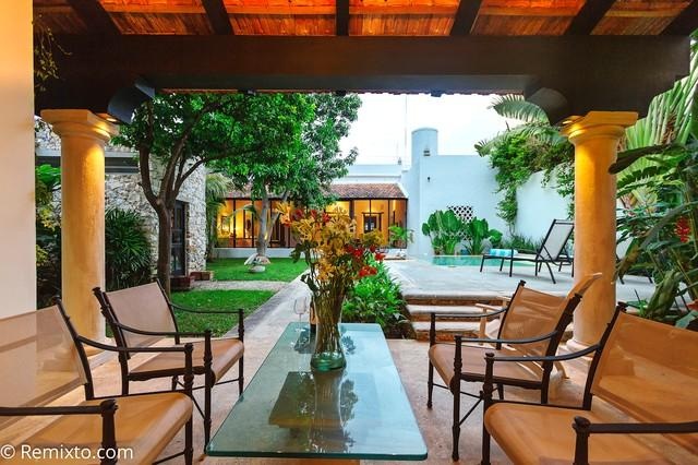 The rear patio separates the two bedrooms and is a perfect spot to read the news or play some games - Escape into Stunning Luxury in Merida - Merida - rentals