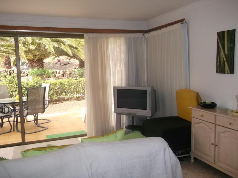 Lounge Area with view onto Patio and Golf Course - Ground floor spacious one bedroom apartment - San Miguel de Abona - rentals