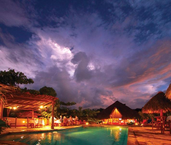 Pool and restaurant/bar taken from volleyball court - Ease and Comfort at La Casa Hola Aloha - San Juan del Sur - rentals