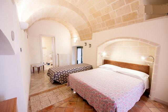 The room has a double bed and a cot. In summer it is very fresh. There is a small kitchen with refrigeretor . Shower Room - beb157  triple room - Matera - rentals