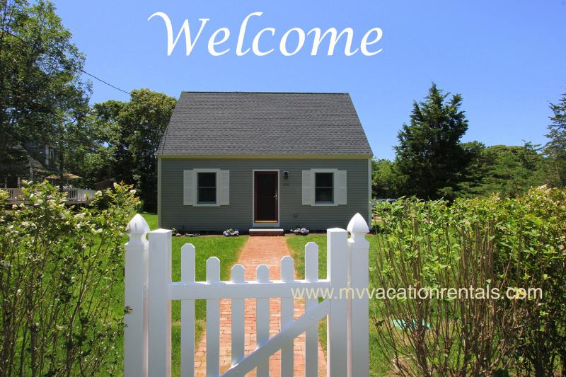 Front of House from Street - MCKAJ - Adorable Pristine Cape, Close to Town Center and Ink Well Beach. Landscaped Yard, AC, Wi-Fi - Oak Bluffs - rentals