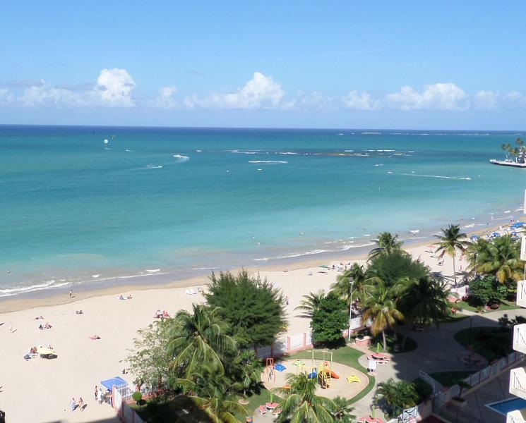 Beach view from our living room doors - Isla Verde BEACHFRONT!  Casa Bonita - Isla Verde - rentals