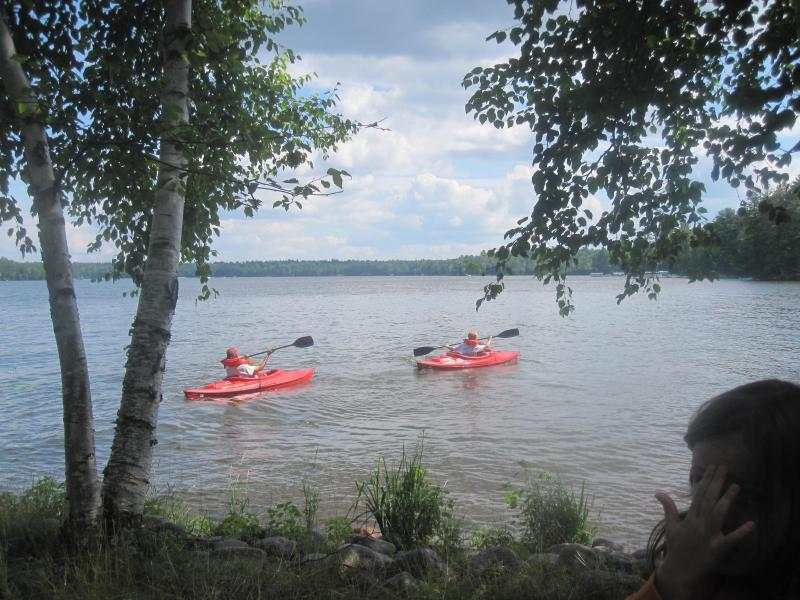 Kayaking just off the cabin's beach - Northwoods Family Getaway on Prime Cranberry Lake (Eagle River, WI) - Eagle River - rentals