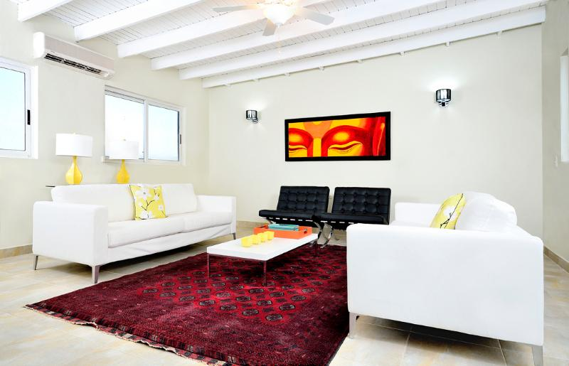 Find yourself relaxing in the tranquility of this bright spacious living room - Aruba Palm Beach Suites - 3 bedroom Luxurious Home - Palm/Eagle Beach - rentals