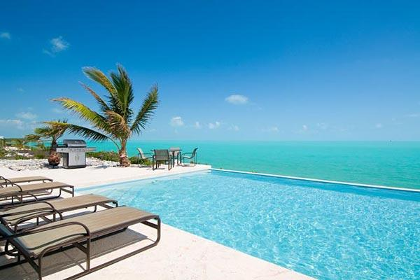 This private, oceanfront villa is situated on the south shore and is surrounded by blue ocean. IE BRE - Image 1 - Leeward - rentals
