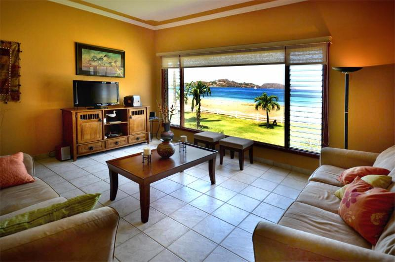 Relax in our living room overlooking paradise every day! - Paradise is yours with Beachfront Condo Azul! - Playa Potrero - rentals