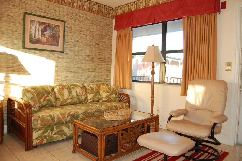 Relaxing living area with Queen size sofa bed & chair with ottoman - Lrg Studio, Walk to Beach Gulf of Mexico Sleeps 2 - Redington Beach - rentals
