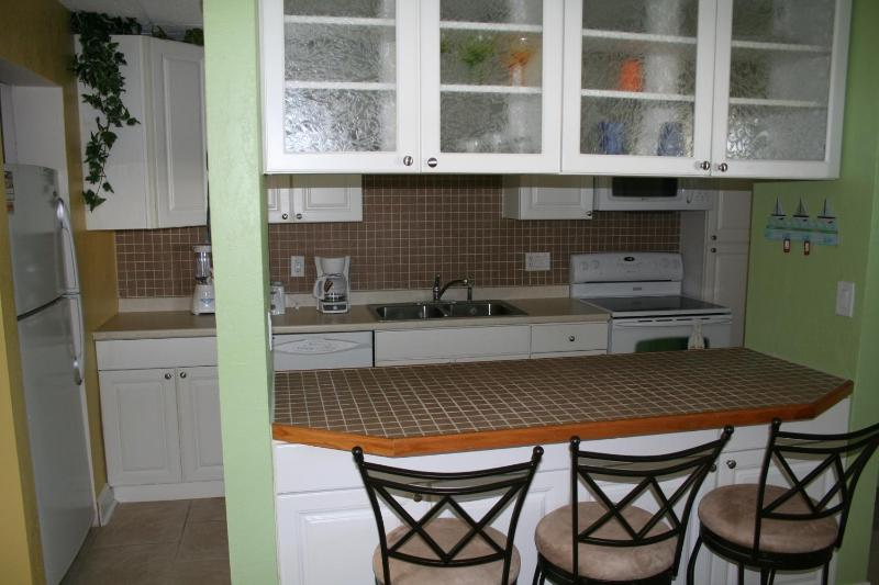 Breakfast bar and kitchen - Gorgeous and Relaxing Cocoa Beach Condo - Cocoa Beach - rentals