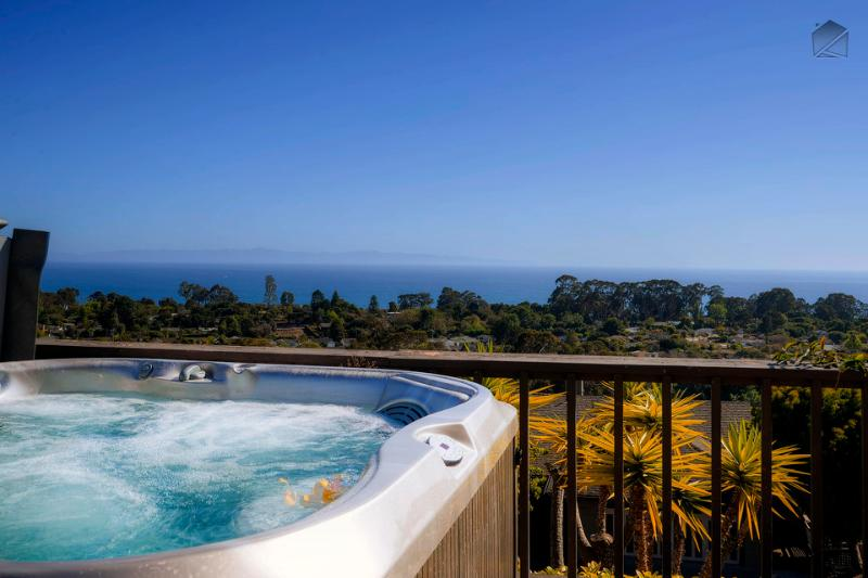 On clearer days, the Channel Islands are easily visible from the hot tub. The tall cluster of trees on the right is Douglas Preserve, a great place to take an afternoon walk. - Panoramic ocean view home with hot tub in Mesa - Blue Horizon - Santa Barbara - rentals