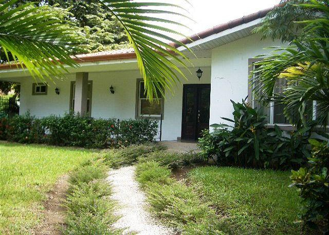 Tropical landscaping surrounds the home. - Casa Wessinger - Walk to the beach! - Playa Hermosa - rentals
